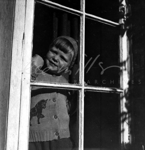 Antony Penrose at window, Farley Farm House, Chiddingly, East Sussex, England 1949 by Lee Miller