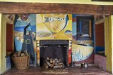 Fireplace mural in dining room at Farley Farm house
