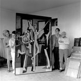 Lee Miller, Jacqueline Roque, Roland Penrose & Picasso with his painting of the three dancers