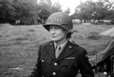 Lee Miller in customised army helmet